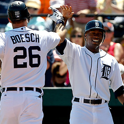 March 26, 2012; Lakeland, FL, USA; Detroit Tigers left fielder Brennan Boesch (26) celebrates with teammate Austin Jackson after hitting a two run homerun during the bottom of the first inning of a spring training game against the Miami Marlins at Joker Marchant Stadium. Mandatory Credit: Derick E. Hingle-US PRESSWIRE