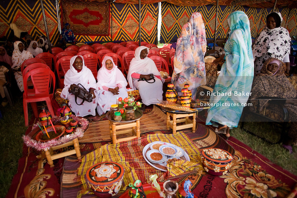 Displaying handicrafts, local ladies attending the first-ever international Conference on Womens' Challenge in Darfur, gather outside a compound belonging to the Govenor of North Darfur in Al Fasher (also spelled, Al-Fashir) where the women from remote parts of Sudan gathered to discuss peace and political issues.