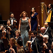 """November 21, 2013 - New York, NY : Soloists including, standing at center, from left, mezzo-soprano Sasha Cooke (grey sequined dress) and  soprano Kate Royal (violet dress) take the stage to perform Bejamin Britten's """"Spring Symphony, Op. 44 (1948-49)"""" at Avery Fisher Hall at Lincoln Center on Thursday night.  CREDIT: Karsten Moran for The New York Times"""