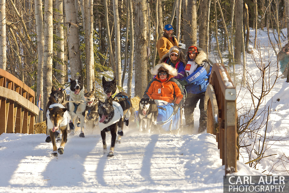 March 7th, 2009:  Anchorage, Alaska - Martin Buser of Big Lake, Alaska brings his team across a foot bridge near Behm Lake during the 2009 Ceremonial Start to the Iditarod Sled Dog Race.