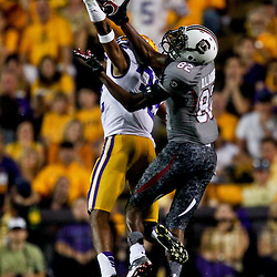 October 13, 2012; Baton Rouge, LA, USA; LSU Tigers cornerback Jalen Collins (32) breaks up a pass to South Carolina Gamecocks wide receiver D.L. Moore (82) during the second half of a game at Tiger Stadium. LSU defeated South Carolina 23-21. Mandatory Credit: Derick E. Hingle-US PRESSWIRE