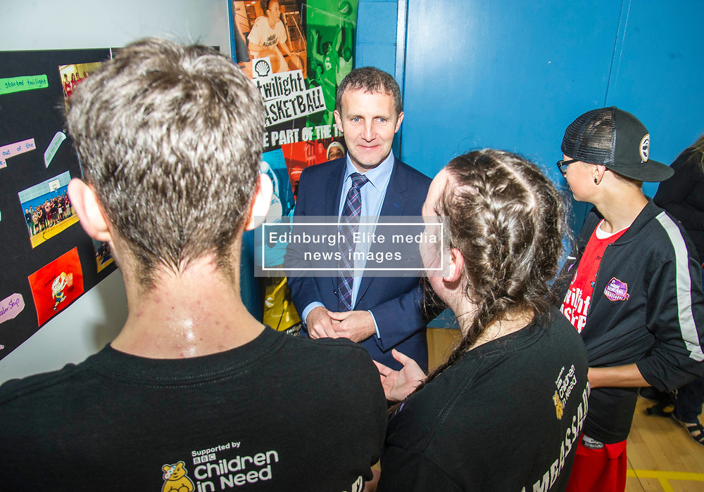 Pictured: The Minister met CashBack ambassadors Vincent Connelly (cap), Amanda Hiddleston and Duncan Watson.<br /> Today, Justice Secretary Michael Matheson visited the Raploch community campus and met young people involved in CashBack-funded basketball sessions. <br />  <br /> Ger Harley | EEm 11 July  2017