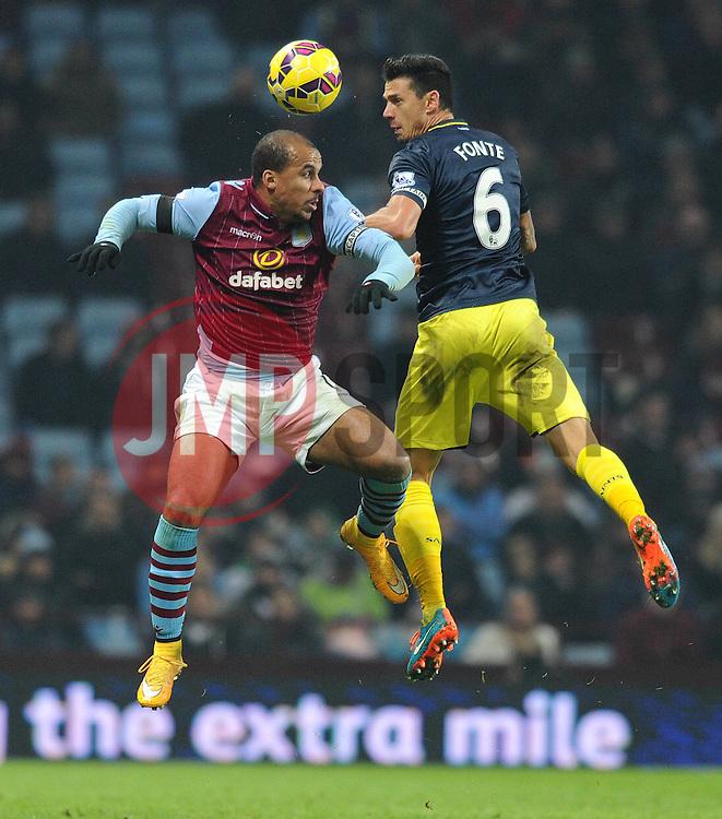 Aston Villa's Gabriel Agbonlahor challenges Southampton's Jose Fonte for the ball - Photo mandatory by-line: Dougie Allward/JMP - Mobile: 07966 386802 - 24/11/2014 - SPORT - Football - Birmingham - Villa Park - Aston Villa v Southampton - Barclays Premier League