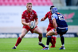 Guinness PRO14, Parc y Scarlets, Llanelli, UK 22/8/2020<br /> Scarlets v Cardiff Blues<br /> Johnny Williams of Scarlets is marked by Matthew Morgan of Cardiff Blues<br /> Mandatory Credit ©INPHO/Ryan Hiscott