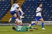Bury Defender, Tom Aldred (15) jumps out of the way of Bury Goalkeeper  Leonardo Fasan (38) during the EFL Trophy match between Bury and U23 Stoke City at the JD Stadium, Bury, England on 8 November 2017. Photo by Mark Pollitt.