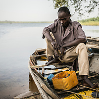 Baga Sola, Lake region, Chad.<br /> <br /> Adam Moussa, 23, lives in a small fishermen village next to Baga Sola. Every morning, he left very early to take his nets set up the night before. This morning he has only 2 small fish. With the driving ban he can only use his small boat on the edge where fish are few.<br /> <br /> Sylvain Cherkaoui/Cosmos for MSF