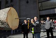 Graig Eichler, of Oneonta, NY, with his wife Angie and children Ava and Brock, drives a spike into the trunk of the 94-foot-tall Norway Spruce from their backyard that will become the Rockefeller Center Christmas Tree in New York's Rockefeller Plaza, Saturday, Nov. 12, 2016. The 84th Rockefeller Center Christmas Tree Lighting ceremony will take place on Wednesday, Nov. 30. (Photo by Diane Bondareff/AP Images for Tishman Speyer)