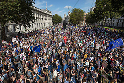 © Licensed to London News Pictures. 31/08/2019. London, UK. Demonstrators on the Stop The Coup march surround the entrance to Downing Street as they fill Whitehall to protest against the government's plans to close Parliament early ahead of the party conference season. Photo credit: Peter Macdiarmid/LNP