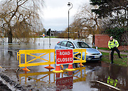 © Licensed to London News Pictures. 29/12/2012. Laleham, UK. A police officer talks to a driver after he ignores road closed signs and drives along a road next to the flooded River Thames in Laleham.  Flooding along the River Thames today 29th December 2012.Forecasters say the UK can expect heavy rain and winds the coming days. Photo credit : Stephen Simpson/LNP