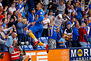 Shrewsbury Town striker Carlton Morris (9), on loan from Norwich City, scores a goal and celebrates to make the score 1-0 during the EFL Sky Bet League 1 Play Off second leg match between Shrewsbury Town and Charlton Athletic at Greenhous Meadow, Shrewsbury, England on 13 May 2018. Picture by Simon Davies.