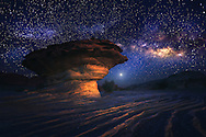 In our area in February, Milky Way arise around 2:00 am so I went to a desert far away from any towns to see the Milky Way and capture a good photo. I have searched for convenient subject to create a beautiful piece of art, then I found this UFO to fit for my composition. Of course it is not a UFO but this rock inspired me this idea.
