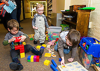 "Adam, Reid and Connor have some ""play time"" with puzzles and blocks following Laconia Library's preschool story hour on Wednesday morning.  (Karen Bobotas/for the Laconia Daily Sun)"