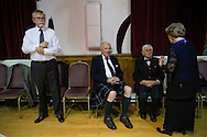 Guests taking a break from dancing at a St. Andrew's dinner dance held by the Sandbach and District Caledonian Society at Sandbach Town Hall, Cheshire, England on St. Andrew's Day. Around 40 people from the Society attended the meal and dance which included a programme of Scottish country dancing. St. Andrew was the patron saint of Scotland and the day was celebrated by Scots worldwide on the 30th November.