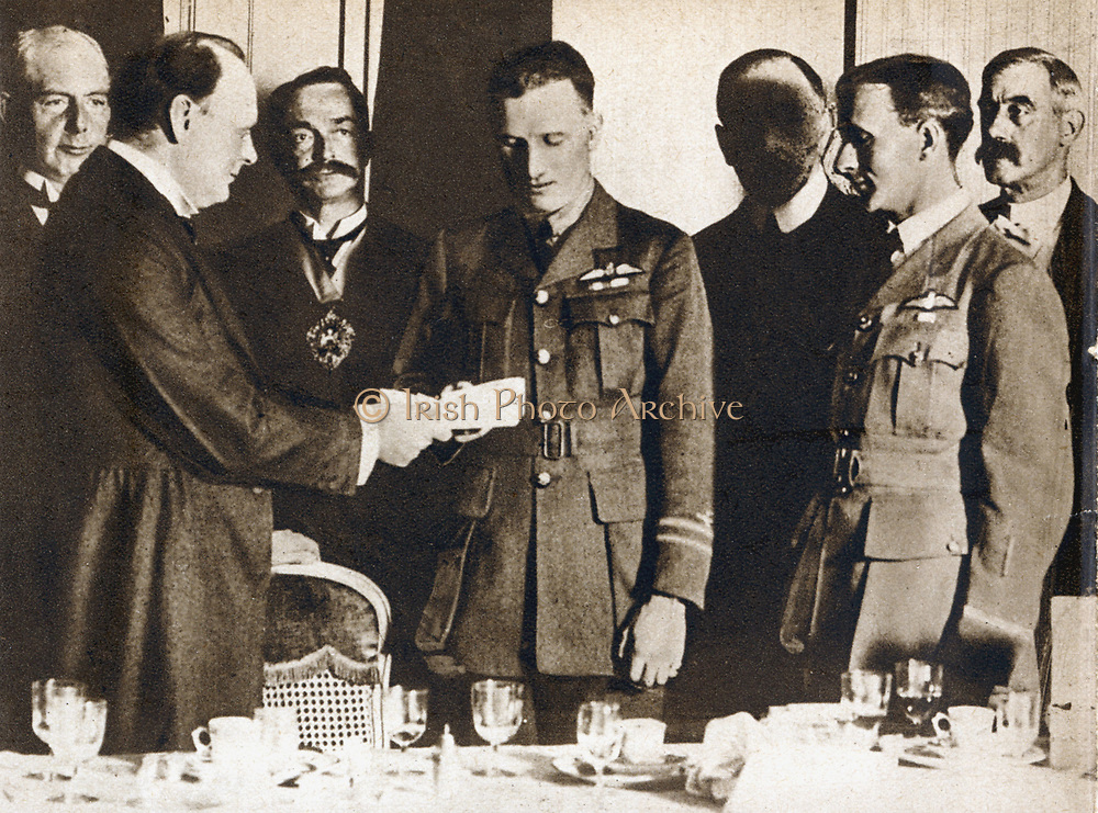 John William Alcock (1892-1919) and Arthur Whitten Brown (1886-1948) British aviators. First men to fly Atlantic non-stop, 14 June 1919. Presented with £10,000 prize by Winston Churchill