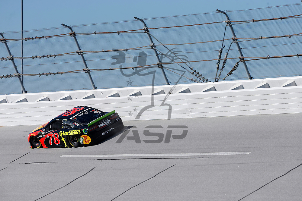 Martin Truex, Jr (78) brings his car through the turn 4 during practice for the 1000Bulbs.com 500 at Talladega Superspeedway in Talladega, Alabama.