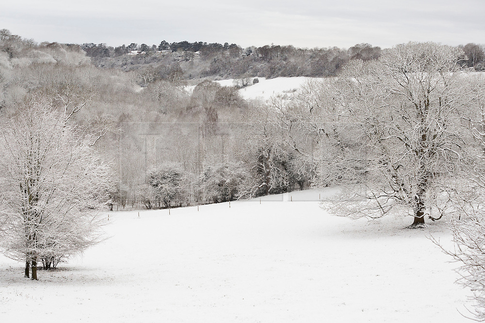 © Licensed to London News Pictures. 17/01/2016. Woldingham, UK. Snow covered fields are seen near the village of Woldingham in Surrey today (17/01/2016) after snow hit parts of the UK for the first time this winter. Photo credit: Matt Cetti-Roberts/LNP
