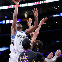 10 April 2014: Minnesota Timberwolves forward Andrew Wiggins (22) goes for the jump shot over Los Angeles Lakers forward Wesley Johnson (11) and Los Angeles Lakers forward Tarik Black (28) during the Los Angeles Lakers 106-98 victory over the Minnesota Timberwolves, at the Staples Center, Los Angeles, California, USA.