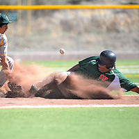 050213  Adron Gardner/Independent<br /> <br /> Wingate Bear Stetson Long (33), right, slides safe into third base after the throw bounces from Thoreau Hawk Jim Largo (17) at Ford Canyon Park in Gallup Thursday.