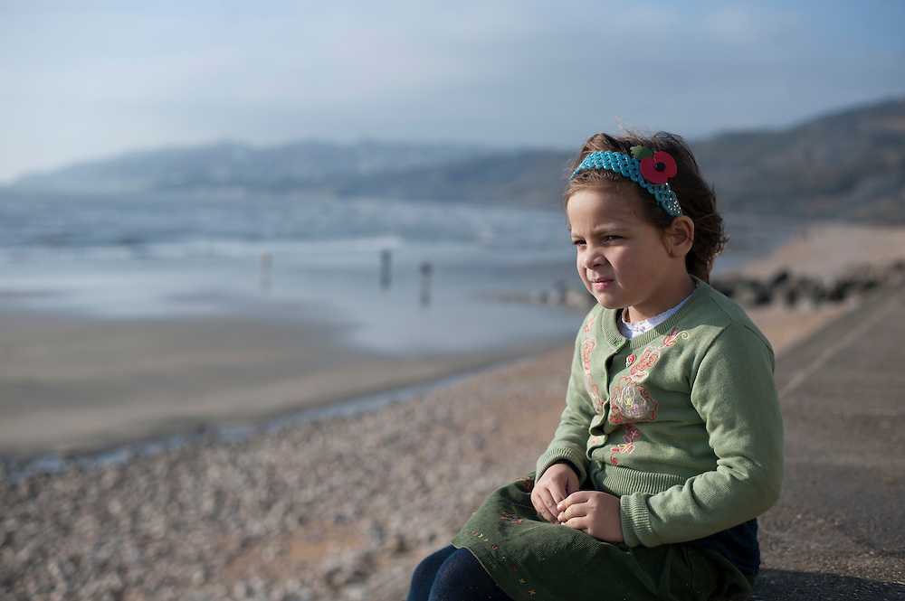 Poppy Price age 5 poses for a photo on Charmouth Beach in Dorset, UK on Remeberance Sunday 13th November 2011../ KI PRICE....