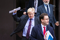 © Licensed to London News Pictures. 14/02/2018. London, UK. Foreign Secretary Boris Johnson (L) leaves The Policy Exchange building by the back door after delivering his Valetine's Day 'Liberal Brexit' speech. Photo credit: Rob Pinney/LNP