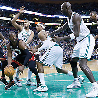 27 January 2013: Miami Heat shooting guard Dwyane Wade (3) looks to pass the ball over Boston Celtics small forward Paul Pierce (34) and Boston Celtics power forward Kevin Garnett (5) during the Boston Celtics 100-98  2OT victory over the Miami Heat at the TD Garden, Boston, Massachusetts, USA.