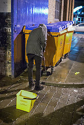 © Licensed to London News Pictures . 18/10/2013 . Manchester , UK . A man scrubs the pavement with disinfectant after being caught urinating near Deansgate Locks . Greater Manchester Police campaign against anti-social micturation . Photo credit : Joel Goodman/LNP