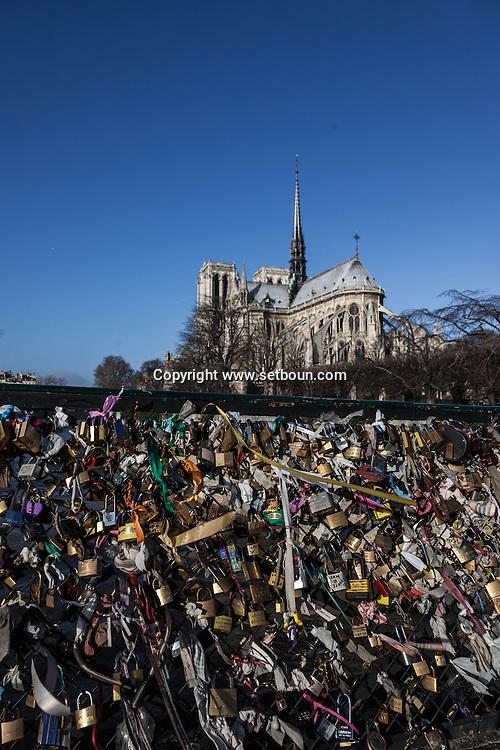 France. Paris 5th district. Archeveche bridge.  love locks . The bridge on the  Seine river  connect  left bank and ile de la cite  / cadenas d amour sur le  le pont de l archeveche sur la Seine entre l ile de la cite et la rive gauche