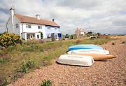 Boats and house on beach, Shingle Street, Suffolk, England