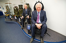 © London News Pictures. File pic date 16/07/2013. L to R John S. Martin (Joint Managing Director) and James W. Martin (Joint Managing Director) sit on ejection seats made over the years by Martin-Baker, manufacturers of ejection seats and crashworthy seating systems in Denham, Buckinghamshire. The ejection seat manufacturer Martin Baker has pleaded guilty at Lincoln Crown Court to Health and Safety offences over the death of Red Arrows Pilot Sean Cunningham in 2011. Photo credit: Ben Cawthra/LNP