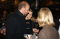 LAURA BAILEY and ERIC FELLNER at a party to celebrate the publication on 'A Year in My Kitchen' by Skye Gyngell held at The Petersham Nurseries, Petesham, Surrey on 19th October 2006.<br />