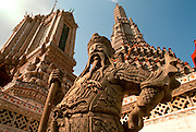 THAILAND, BANGKOK the famous Wat Arun Buddhist Temple with ornate sculptured Guardian figure
