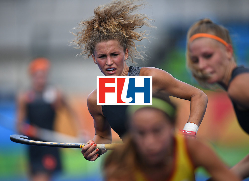Netherland's Maria Verschoor (top) competes during the women's field hockey Netherlands vs Spain match of the Rio 2016 Olympics Games at the Olympic Hockey Centre in Rio de Janeiro on August, 7 2016. / AFP / MANAN VATSYAYANA        (Photo credit should read MANAN VATSYAYANA/AFP/Getty Images)