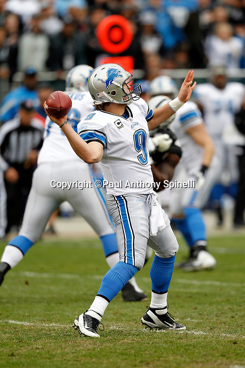 Detroit Lions quarterback Matthew Stafford (9) throws a first quarter touchdown pass that ties the score at 7-7 during the NFL week 15 football game against the Oakland Raiders on Sunday, December 18, 2011 in Oakland, California. The Lions won the game 28-27. ©Paul Anthony Spinelli
