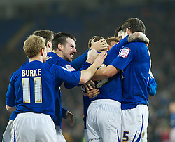 CARDIFF, WALES - Tuesday, February 1, 2011: Cardiff City's Craig Bellamy celebrates  with his team mates scoring from a free kick in the last minute of extra time to draw 2-2 against Reading during the Football League Championship match at the Cardiff City Stadium. (Photo by Gareth Davies/Propaganda)
