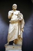 Euripedes (c480-406 BC) Ancient Greek tragedian holding mask of tragedy. Full length statue.