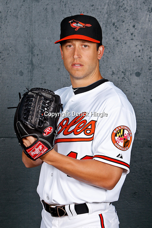 February 26, 2011; Sarasota, FL, USA; Baltimore Orioles relief pitcher Jason Berken (49) poses during photo day at Ed Smith Stadium.  Mandatory Credit: Derick E. Hingle