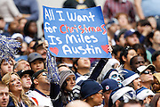A Dallas Cowboys fan holds up a sign during a timeout against New Orleans Saints at Cowboys Stadium in Arlington, Texas, on December 23, 2012.  (Stan Olszewski/The Dallas Morning News)