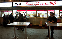 Night view of famous Konnopke`s Imbiss in Prenzlauer Berg Berlin which is possibly the most famous place to buy Currywurst