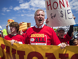 May 23, 2019, Urbandale, Iowa, U.S.: BILL DE BLASIO, center, mayor of New York City, participates in a picket of a McDonald's in Urbandale, a suburb of Des Moines. De Blasio called on the fast food chain to raise its minimum wage to $15.00 per hour and improve worker safety. The picket was a part of a series of pickets of McDonald's across the US. De Blasio joined the field of Democrats vying to be the party's candidate in the 2020 presidential election last week. Iowa traditionally hosts the the first election event of the presidential election cycle. The Iowa Caucuses will be on Feb. 3, 2020. (Credit Image: © Jack Kurtz/ZUMA Wire)