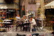 Image of an outdoor cafe reflection in the town of Mittenwald in Bavaria, Germany