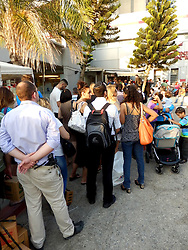 People wait to receive gas-masks in Tel Aviv. <br /> People queue to receive new gas-masks or get replacements in a suburb of Tel Aviv as tension mounts over allied military strikes in Syria and Iran threatens Israel if Syria is hit, <br /> Tel Aviv, Israel.<br /> Friday, 30th August 2013. Picture by Max Nash / i-Images