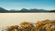 Scenic view of lake and mountains along the Alaska Highway in the Yukon Territory. Winter. Morning.