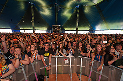© Licensed to London News Pictures. 22/08/2014. Reading, UK.   Audience watch the opening act of Reading Festival 2014, Gerard Way performing live at Reading Festival 2014 on Friday, the opening day, in his first solo shows.  Gerard Arthur Way was the lead vocalist and co-founder of the band My Chemical Romance from its formation in November 2001 until its split in March 2013.   Photo credit : Richard Isaac/LNP