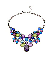 Colored gem necklace on white background