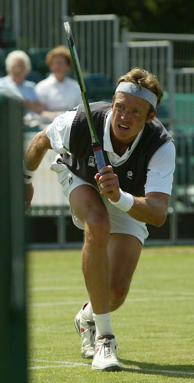 LIVERPOOL, ENGLAND - THURSDAY JUNE 10 2004: Jan-Frode Andersen (NOR) in action during the Liverpool International Tennis Tournament at Claderstones Park. Andersen lost 6-1, 7-5. (Photo by David Rawcliffe/Propaganda)