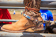 14 JULY 2012 - OAK SPRINGS, AZ:  A cowboy's boot at a bull riding class in the Aspen Canyon Rodeo Club in Oak Springs, AZ. The bull riding class was offered by the Crooked Horn Cattle Co. in the community of Oak Springs on the Navajo Nation, about 15 miles south of Window Rock, AZ. Eleven cowboys signed up for bull riding classes and one signed up for bull fighting classes. The bull riding class started with lessons on a mechanical bucking machine before the cowboys rode bulls.    PHOTO BY JACK KURTZ