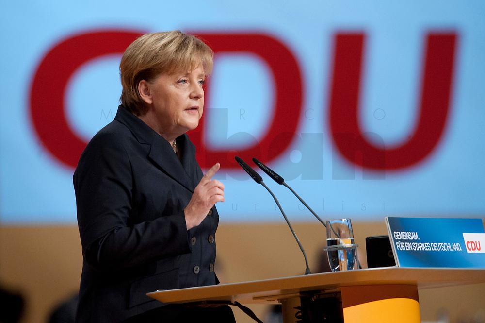 15 NOV 2010, KARLSRUHE/GERMANY:<br /> Angela Merkel, CDU, Bundeskanzlerin und CDU Bundesvorsitzende, waehrend ihrer Rede, CDU Bundesparteitag, Messe Karlsruhe<br /> IMAGE: 20101115-01-228<br /> KEYWORDS: party congress, speech, Parteitag