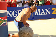 Travis Ortmayer (USA) retires from the Atlas Stones event due to an ankle injury sustained in the overhead log-lift during the final rounds of the World's Strongest Man competition held in Sun City, South Africa.