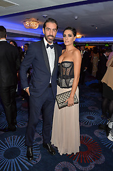 Footballer ROBERT PIRES and his wife JESSICA LEMARIE at the Chain of Hope Ball held in aid of the charity Chain of Hope, founded by Professor Sir Magdi Yacoub which organises volunteer teams worldwide to operate on children suffering from life-threatening heart diseases, held at the Grosvenor House Hotel, Park Lane, London on 20th November 2015.
