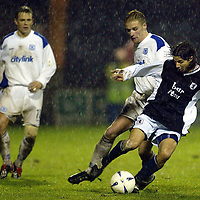 Raith Rovers v St Johnstone...29.11.03<br />Beto Crranza released by Dundee earlier in the week is tackled by Ryan Stevenson after making his debut for Raith<br /><br />Picture by Graeme Hart.<br />Copyright Perthshire Picture Agency<br />Tel: 01738 623350  Mobile: 07990 594431